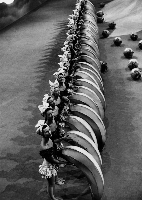 "Banana-wielding chorus girls on the set of Busby Berkeley's The Gang's All Here (1943) rehearse the Lady in the Tutti-Frutti Hat routine, which was aptly described by one critic as ""a male hairdresser's acid trip"" (via Hollywood Musicals)"