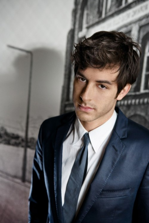 whytheyrehot:  Why He's Hot:  Say hello to Mark Ronson everybody. Not only is he smoking hot, he's talented too. Whether he's playing the role of badass DJ, jamming with his band or even just riding a bike, the man looks good. Makes you wonder if his talents stretch beyond his music and carry over to the bedroom. Have you seen him in a suit? Or decked out in make up for Halloween? No matter what he's wearing, it makes people everywhere want to rip his clothes off with their teeth.  The hair. It can be brown, platinum blonde, in a nice coif or shaggy, you'd still want to run your hands through it while he makes love to you on every surface you can imagine. As if his face wasn't perfect enough, he's got those luscious lips to top it all off. His smirk could cause even the saintliest of people to fall to their knees, and not in prayer. And when he smiles, the heavens open up and angels cry because it's just that beautiful. Oh, I forgot to mention one tiny little tidbit of information; he's English. So that combined with everything else listed above makes for one delicious man. {submission}  Hello Mark!