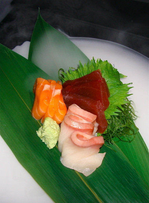 Ninja Part 6. Floating Sashimi Salmon, Red Tuna, and White Tuna Sashimi beautifully sliced on a bed of dry ice. Ninja. New York, New York.