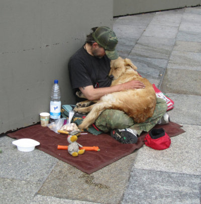 This is so touching. A homeless who is barely able to take care of himself, taking care of a dog. Sometimes, you just need a little love, not just things.  reblog if you care.