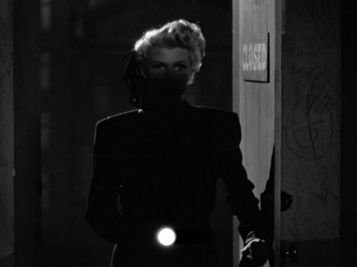 "Rita Hayworth in The Lady From Shanghai (Orson Welles, 1947) (via bswise) (More stills over at foxesinbreeches) ""The femme fatale is the figure of a certain discursive unease, a   potential epistemological trauma. For her most striking characteristic,   perhaps, is the fact that she is never really what she seems to be. She   harbors a threat which is not entirely legible, predictable, or   manageable. In thus transforming the threat of the woman into a secret,   something which must be aggressively revealed, unmasked, discovered,  the  figure is fully compatible with the epistemological drive of  narrative,  the hermeneutic structuration of the classical text.  Sexuality becomes  the site of questions about what can and cannot be  known. This  imbrication of knowledge and sexuality, of epistemophilia  and  scopophilia, has crucial implications for the representation of  sexual  difference in a variety of discourses - literature, philosophy,   psychoanalysis, the cinema. Both cinematic and theoretical claims to   truth about women rely to a striking extent on judgments about visions   and its stability or instability. Although her origins are literary and   pictorial, the femme fatale has a special relevance in cinematic   representation, particularly that of Hollywood insofar as it appeals to   the visible as the ground of its production of truth."" ""In what does the deadliness of the femme fatale consist and why is   she so insistently a figure of fascination in texts of modernity? Her   power is of a peculiar sorrt insofar as it is usually not subject to her   conscious will, hence appearing to blur the opposition between   passivity and activity. She is an ambivalent figure because she is not   the subject of power but its carrier (the connotations of   disease are appropriate here). Indeed, if the femme fatale   overrepresents the body it is because she is attributed with a body   which is itself given agency independently of consciousness. In a sense,   she has power despite herself. The evacuation of intention   from her operations is fully consistent with the epistemological   recognition accorded to the newly born psychoanalytic concept of the   unconscious. The femme fatale is an articulation of the fears   surrounding loss of stability and centrality of the self, the ""I,"", the   ego. These anxieties appear quite explicitly in the process of her   representation as castration anxiety.  […] The power accorded to the   femme fatale is a function of a fears linked to the notions of   uncontrollable drives, the fading of subjectivity, and the loss of   conscious agency - all themes of the emergent psychoanalysis. But the   femme fatale is situated as evil and is frequently punished or killed.   Her textual eradication involves a desperate reassertion of control on   the part of the threatened male subject. Hence, it would be a mistake to   see her as some kind of heroine of modernity. She is not the subject  of  feminism but a symptom of male fears about feminism. Nevertheless,  the  representation - like any representation - is not totally under the   control of its producers and, once disseminated, comes to take on a  life  of its own."" — Mary Ann Doane, Femmes Fatales: Feminism, Film Theory, Psychoanalysis (1991)"