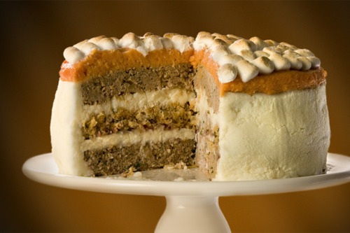 thedailywhat:  Kickass Cake of the Day: Put your boring day-after-Thanksgiving sandwich on hold this year and try out CHOW's Thanksgiving Turkey Cake instead: Layers of ground turkey, sausage stuffing, mashed potatoes, and cranberry sauce coated with more mashed potatoes, a layer of sweet potatoes, and a cup-and-a-half of mini-marshmallows. Gravy optional. [geekologie.]  Does this cake remind you of Rachel's traditional English trifle in 6x09 TOW Ross Got High?