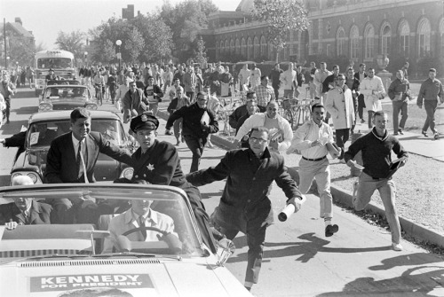 suitep:  John F. Kennedy campaigns in Illinois in 1960. The most recent issue of TIME has a big spread of pictures from LIFE.com, never before seen, marking the 50th anniversary of JFK's election to the presidency. The magazine's caption for this picture notes the sense of fun it conveys—and how, in hindsight, it evokes the tragedy of the motorcade in Dallas three years later.