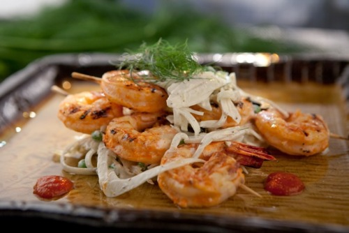 Ming Tsai: Grilled Sriracha Shrimp Satay with Ginger-Yogurt Fennel Salad Ming Tsai, chef of the celebrated Blue Ginger restaurant, host of Simply Ming, and current contestant on The Next Iron Chef shares his recipe for Shrimp Satay, marinated in Sriracha hot chili sauce and garlic, perked up with a squeeze of lime juice. The heat of the Sriracha is contrasted nicely with a cool shaved fennel and pea salad dressed with Greek yogurt, ground coriander, and ginger. Recipe: Sriracha Grilled Shrimp Satay with Ginger-Yogurt Fennel SaladFollow @SimplyMingTV on TwitterLike Simply Ming on Facebook Photo by Emily Sterne