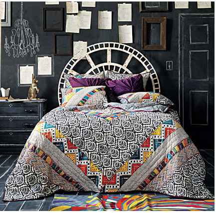 via Anthropologie The quilt & chalkboard wall combo is delicious. Eclectic goodness!
