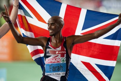 European champion at 5,000 and 10,000 meters, Mo Farah shows off his typical flag waving Muslim garb.