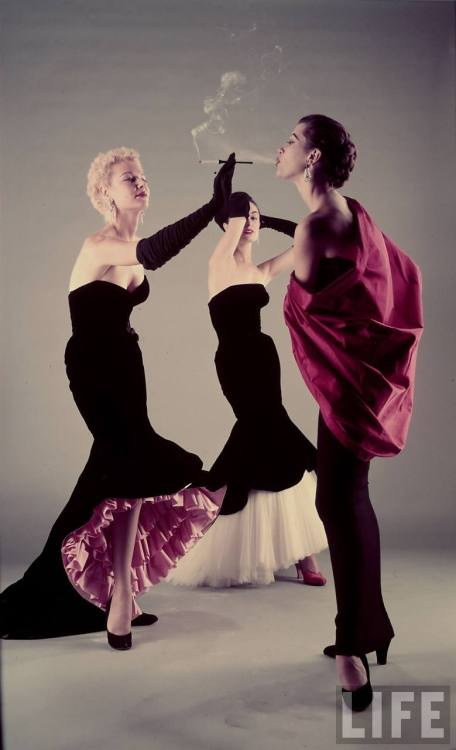 Hitchcock Directing Three models wearing evening dresses by designer Balenciaga inspired by Toulouse-Lautrec paintings, NY 1951 by Gjon Mili