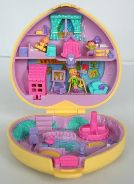 The girl version of our Mighty Max, Polly Pocket. If there isn't something like this out now there should be.