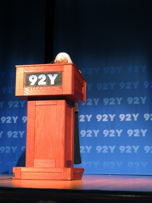 "meaghano:  I went with Jen Snow to this reading at the 92Y the other night—""what goes on in there?"" my cabbie asked, ""after stuff goes on there I always pick up old Jewish people in those little hats, what're those things called again? Want a peanut M&M?"" (all kinds of things! yarmulkes! yes, please, if you promise they aren't poisoned!)—and she took this picture of Cynthia Ozick that is so obviously THE BEST that it makes me scream inside every time I see it. She read after Nicole Krauss, who I'd never seen in person before—it was odd to see her be a human, with dangly earrings and long, black hair, me guessing just how old she was, wondering if I liked her less or more for her pat answers, the way she talked about embodying characters inner lives like it was a revelation. Maybe it was, to some or maybe it never really stops being that, as much as we can roll our eyes at it and wonder when Cynthia Ozick will be coming onstage. Nathan Englander talked about her so well, though, in his introduction—about which she was perfectly self-deprecating and gracious; what a skill, you know—that I had to kind of sigh and throw up my hands. He talked about how for awhile there everyone on the subway was curled around a copy of A History of Love, he wondered to us how many people may have been late to yoga or to pick their kids up from daycare (HOLY ACCURATE DEMOGRAPHICAL ANECDOTES, BATMAN!) and I was like okay TRUE, I WAS ALSO LATE FOR YOGA AND LATE TO PICK UP MY KID EXCEPT HE WAS NOT MY KID, I WAS THE DAYCARE, and I have a handful of fluttery tumblr posts to prove it. She started to read from Great House and I got over the dangly earrings and her regular person-ness and I loved it. I leaned my head back on my seat and listened the whole time, the way I can rarely do at a reading, be actually taken in and paying attention, not just judging the patterns of someone's tie or dress or how they sip their water, wondering if I could ever be like them. She's so good, I think. I just like where she goes, where she seems to be coming from, where it seems like her heart is. I am grossly sentimental I suppose, and she makes me admit it, because I love her. I want to read that book. Then came Cynthia O, who was described by her equally small Introducer as ""prodigious."" I wrote this word down on my program because it struck me as such a good, good word. I think all the Nicole Krauss had already gone to my head. She barely peeked over the podium and our hearts sang at this, everyone there already in love with her before she opened her mouth. Her jokes felt less cloying, less rehearsed, her earrings not dangling. She feels more like a writer so it doesn't bother you as much; maybe it's because she's old but it sounds right—every word from her mouth the perfect one. Her new book, Foreign Bodies, is a post-WWII challenge to the Jamesian notion of Europe as the center of culture (TEEHEE, WROTE THAT ONE DOWN), and from what I could tell of what she read—I paid attention here, too!—is about these ideas of romance and wanting to run away and be fulfilled without acknowleding all of the privilege necessary to even want that, and how that Hemingway-ish (or Jamesian as she much better elucidated) writing-in-a-cafe-stuff stuff seems a little gross after ya know, all the mass-murdering. So now, she's basically saying that America is that place, that ""vortex of civilization,"" even though we are The Worst for plenty of reasons.Well that is what she says it is about, although the part she read was more about this guy we all probably know/are, those ""imitation Baby Sartres"" (YESS, totally wrote that down and circled it) with the ground ""so obliviously soft under their feet,"" who leave their ""waiting, rich cities,"" to go Find Themselves or what have you. God she is great. Other things I wrote down: ""he was being scolded—worse, he was being exposed"" #DAMNNN she looked at him with something ""both more and less than annoyance, the kind of look you throw on a child that has thrown a rock that was meant to hit you but doesn't."" I'm sorry but can't you see that look exactly? How better to describe it? We got it totally in our heads. gODDAMN. Also ""he tried to deserve them"" I don't know what he was trying to deserve or how but I love the idea of trying to deserve something, because, yes. In the Q&A old Cynthia Ozick basically threw it down and said she hasn't been very impressed with contemporary ""workshop"" (zing!) poetry, that it has stopped aiming towards the transcendent. Eyebrows were raised, applause rung out. She talked about how all writers begin as poets, then a winnowing out occurs. She said either Goethe or Wilde or Eliot said that. Someone asked Nicole Krauss what it was about old men that intrigued her so much. I laughed too loudly, the old jewish people all around me gave me a Look. Nicole said something perhaps unintentionally dismissive about how she always gets asked that. Don't say that! It makes the Asker feel unoriginal, the cardinal sin of question-asking. Gosh, have you ever asked a question at a reading? I haven't. I keep thinking one day but lord, what is the point?"