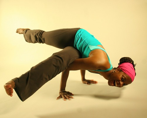 love the smile!  proyogi:  one of my favorite arm balances Parsva Bakasana - Side Crow Variation photo credit: MC Wolfe  18° 15' N, 77° 30' W