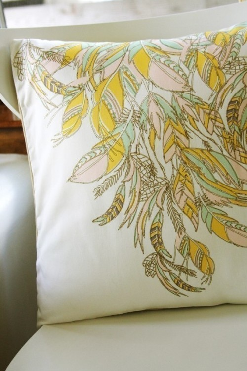 Yes, please. Feathers pillow by illustrator/artist/textile designer Leah Duncan.