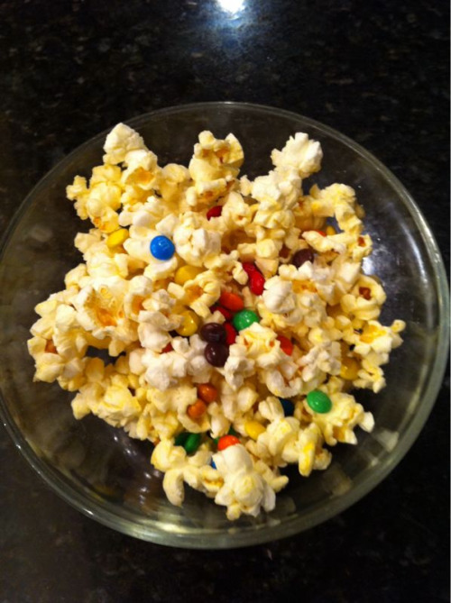 Sometimes mama hooks it up… Kian's afternoon treat. (popcorn and m&ms)