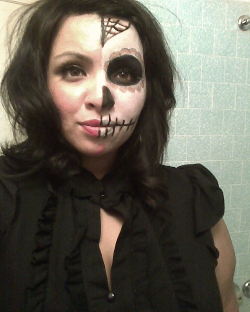 This is my Halloween picture! Dia de los Muertos face…i cant imagine doing my whole face half took long enough.