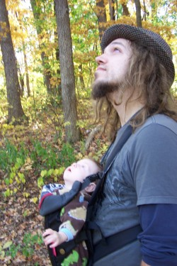 My hubby, Jehosh, wearing baby River on a recent hiking trip. He loves being able to be so close to her. (via SquirrelyMama)