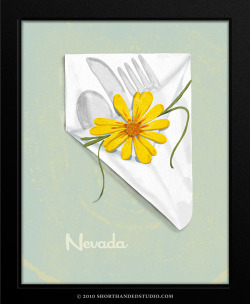 Silverware wrapped in napkin with flower
