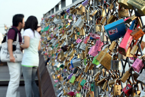 "This is ""The Safest Wall"" in Seoul, South Korea. Young couples show their love for each other by locking a pair of padlocks to this fence, and throwing the keys over the edge. By throwing away the keys, they are showing their undying commitment to each other. And if you are out there, I promise I will take you to this place. I hope you exist. I'm waiting.  And then he cheats on you   LOLOLOL."