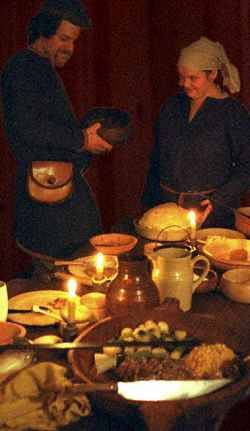 "Preserved foods of the Viking Age   Why food preservation is important While the urban population during the Viking age may have had access to frequent markets or food stalls, the majority of the (rural) Vikings population had to rely on food preservation to survive the winter.  Most Viking farmers had comparatively small holdings, and produced food mainly for the subsistence of their own families, rather than generating cash crops what would allow them to purchase food from external sources. Starving sucks In a subsistence farming economy, each farming household had to rely on the produce of their farm for the majority of their living.  Given the short growing season in the North, it was even more important to preserve the farm's produce over the winter. No refrigeration Almost all of the techniques for food preservation that we rely upon today were unknown in the Viking Age.  There were no refrigerators, no canned food, and no freeze drying (at least as we know it today).  The Vikings had to rely on traditional methods of food preservation. Some vegetable foods can be preserved in their ""raw"" form over the winter, particularly in a cool climate.  Onions, root vegetables, and to some extent cabbages can be preserved by burying them in sand or loose soil, or storing them in hay in a cool place like a root cellar.  Since Viking cabbages were not headed cabbages like we have today, they probably didn't hold up to such treatment as well as modern head cabbage. How was food preserved Drying Many different foods can be preserved by drying, including grain, meat and fish, vegetables and fruit.  Drying is well suited to the cold and often windy conditions prevalent in Northern Europe, and requires little in the way of resources.  Dried food can be kept for long periods of time as long as it is kept away from moisture.  Foods with a high fat content do not dry well without salt or other anti-bacterial agent. Pickling Many different foods can be pickled, either in vinegar, salt, or other acids such as soured whey.  In areas where salt was affordable, meat, vegetables and fish can be pickled in salt.  In areas where salt was more expensive or unavailable, the same foods could be preserved in vinegar or sour whey.  Soft vegetables, and fattier meats such as pork lend themselves well to pickling. Salting Some foods can be preserved in salt without liquids, such as some cheeses, smoked fish, or fatty meats like pork.  However, the farther north you go in the Viking world, the less likely it is that salt was readily available or affordable.  In Iceland salt was essentially absent, so pickling in acid or drying were much more practical.  In the South, such as parts of Denmark or the Danelaw in England, salt would have been more available and affordable, making things like bacon, ham, or smoked fish more popular. Fermentation There are a whole host of bacteria that can be employed to preserve food for human consumption.  Lactobacilli can pickle meat and vegetables by producing acid in liquids.  Cheese, soured milk, and other dairy ferments are all produced by bacteria as well.  Fermentation also produces alcohol, vinegar, and a wealth of other healthy and long-keeping foods. Smoking Smoking is particularly important in keeping food that has a high fat content and will not be kept in liquid, such as ham, bacon, smoked fish or smoked cheeses.  Smoking by itself is not sufficient, and smoked foods usually need to be salted as well.  Smoke was also used to preserve some foods on a day to day basis.  Dried breads were hung from a pole or string over the hearth, where the heat and smoke kept them dry and free from insects. What was preserved Grains Grains such as barley, rye and oats can be preserved for a limited time just by drying.  But grain in bins can only last so long.  There are several ways of making the calories from grain last longer. Bread Bread or crackers baked hard will keep longer than grain by itself.  Hard tack or crisp bread dried completely and stored in either waterproof containers or over the fire will keep nearly indefinitely.  They are easy to eat, easy to store, and easy to transport.  Thin dried bread (like modern rye crisps) can be eaten plain or with fish, cheese, or whatever you might have.  Hard tack is best soaked or cooked in liquid before eating.  You can break up hard tack for ""porridge"" or use it to thicken soups. Beer Calories from grain can also be preserved in the form of beer.  By converting some of the grain's starch to alcohol, bacteria or other contaminants can't grow, and the calories are preserved.  However, it is unclear how long the kind of beer made by the Vikings would really have kept.  Given the brewing techniques available, beer may have been comparatively perishable. Fruit The Vikings had access to a wide variety of fruits, and many of those are comparatively easy to store.  Some fruit can be dried, some pickled, and a few might keep in a cool place well into the Fall at least. Dried Several easily dried stone fruits, including cherries and plums of various kinds were known to the Vikings.  Apples can be dried as well, and some berries can be dried in a dry enough climate. Pickled Apples in particular are traditionally pickled all over Europe today, and lend themselves well to it. Frozen? It is traditional in Finland to store lingonberries in water, which then freezes during cold weather.  There's no evidence (that I've seen) to suggest this was common in the Viking Age, but it's not something that would be likely to show up in the archeological record. Vegetables Cold storage Some vegetables will keep for a long time in cold storage if properly packed and cared for, such as turnips, carrots, parsnips, onions, and garlic.  See above note on cabbages. Pickles The most likely way to preserve vegetables is by fermenting them.  Lactic acid pickles are easy to make, delicious and nutritious to eat, and contribute to a healthy digestive system (as modern science is rediscovering).  Sauerkraut and ""kosher"" or ""sour"" dill pickles are good modern examples, but other vegetables like turnips, carrots, celery and others can all be pickled this way.  Once you have a good bacterial culture, such pickles can be made with little to no salt, as it is primarily the lactic acid produced by the friendly bacteria that keep out the unfriendly ones. Meat Salt The most common way to preserve meats is with salt.  Salts of various types (sodium/potassium/etc.) keep unfriendly bacteria from getting into meat and allow it to be stored for long periods.  Smoking will help fattier meats keep longer than salt by itself, as will immersing them in liquid (brine) since the liquid helps keep oxygen away from the meat. Acid Acid solutions such as vinegar or soured whey can also be used to preserve meats.  Sausages in particular have traditionally been pickled in brine, in vinegar, in sourced whey, or by themselves.  In Iceland they still use sour whey to preserve sausages made at slaughtering time, and such was most likely the case in the Viking Age as well.  Some traditional (i.e. early modern) sausages are made with rye flour added to them.  When rye flour is left in water, it sours naturally, so the rye-laden sausages were placed in jars of water that soured and thus preserved the sausages.  Note: any such meat preserved in acid without salt is cooked first before being submerged. Fish Pickled Many oilier fish can be readily pickled.  Herring, sardines, anchovies and possibly mackerel-esque fishes can be pickled in salt or in a lactic acid solution.  The pickled herring that adorn the modern Scandinavian table are certainly different, since they tend to contain a fair amount of sugar and spices that were unavailable in the Viking period, but the overall effect would have been the same.  Chopped up bits or herring suspended in a sour solution, possibly with the addition of some salt if available. Dried One of the great mainstays and staple foods of the Viking world was dried cod.  Because cod contain almost no fat, they can be dried hard in the cold and windy Scandinavian climate, and will keep pretty much as long as they can be kept dry.  The Viking warriors who travelled overseas took dried cod with them, and in a pinch were known to gnaw on the dried fillets all by themselves.  In a more comfortable setting, the stockfish, or klipfisk, would have been soaked in liquid until they were soft(er) and made into soup or mixed into other dishes. Smoked If salt is available, oilier fish can be smoked.  Salmon, herring, haddock, and mackerel can be smoked and preserved for long periods, although not as long as cod. Dairy products Only a very few Scandinavians are lactose intolerant compared with rates in the rest of the world.  It has long been speculated that this is because dairy products are easy to produce and the keep in their climate, which makes the ability to digest milk into adulthood a survival characteristic.  Whether that is true or not, it is certainly true that milk and milk products have long played an integral role and source of nutrition in Scandinavia since well before the Viking Age.  Dairy products are one of the few food products mentioned in the sagas, so there is some good documentary evidence for milk and milk products in the Viking period. Sour milk If raw (unpasteurized) milk is left out in mild temperatures, it will naturally grow lactobacilli that cause it to sour.  Sour milk was commonly drunk as a beverage and probably used in cooking, baking, and in making cheese.  In early modern Sweden, sour milk was mixed with small beer both as a beverage and as a cooking medium.  If sour milk is heated, it will coagulate, and can then be drained to make a simple cheese to be eaten fresh, or preserved with salt or further bacterial action as cheese. Cheese The simplest fresh or ""farmer's"" cheese can be made from soured milk or fresh milk which is heated and coagulated by the addition of soured milk or other acids. Milk can also be combined with rennet to create a whole variety of cheeses and cheese products.  If salted and dried, ""hard"" cheeses can be kept for very long periods of time without spoiling. Skyr Skyr is somewhere between a cultured milk and a cheese.  It is cultured with lactobacilli much like yogurt of buttermilk, but it also is coagulated with rennet.  Once the rennet causes it to set, the curds are drained, and the result is very similar to a drained yogurt.  It is mildly sour and quite dense, and contains a great deal of protein.  Skyr is traditionally made with skim milk, since the milk fat was used to make butter.  Skyr was a mainstay of the Icelandic diet, and was eaten by itself, with fruit, or mixed into porridge or other dishes to stretch them and to add additional protein. Butter The milk fat from cow's milk is easily converted into butter, which has a much longer shelf life than fresh milk.  Also, since the Vikings tended to make butter from cultured or soured milk, the additional acid content would help preserve the butter. Other cultured milk products The documentary evidence speaks mainly of ""sour"" milk, but it is unclear if that means raw milk that sours naturally, or milk which was intentionally cultured.  In modern Scandinavia, there are a number of cultured milk products that are ""traditional"" (meaning at least early modern) but there is no telling how far they go back.  Piima, viili, and fil mjolk are all examples of modern Finnish or Swedish dairy cultures.  They are fairly easy to obtain and to propagate, and may come close to simulated the naturally soured milk that we can no longer achieve with pasteurized milk today. What evidence do we have? Unfortunately, fermented foods are difficult to distinguish in the archeological record.  Most food products decompose rapidly, and if anything is left it is the hard parts like seeds and bones, where it would be almost impossible to tell if they came from preserved foods or fresh.  There is some evidence from the sagas about butter, cheese, skyr and sour milk, as well as dried cod.  Several pieces of carbonized breads have been found in various Viking contexts, and good analysis has been done on their composition. Luckily, a few artifacts have survived that are linked to food preservation The bottom board from a rectangular cheese press made of wood, similar to those used in Aland in the early modern period Several wooden butter churns Curd strainers, both wooden and hair Vegetable matter from potsherds consistent with fermentation References Primary sources Hansson, Ann-Marie. On Plant Food in the Scandinavian Peninsula in Early Medieval Times.  Theses and Papers in Archaeology B:5. Stockholm: University of Stockholm. 1997. Isaksson, Sven.  The culture of food in Early Medieval Middle Sweden.  A pottery use perspective.Food and Rank in Early Medieval Time. Stockholm: University of Stockholm. 2000. Jørgensen, G. et al. Analyses of Medieval Plant Remains, Textiles and Wood from Medieval Svendborg. The Archaeology of Svendborg 4, Odense: Odense University Press. 1986. Early modern references Bringéus, Nils-Arvid. ""A Swedish beer milk shake.""Milk and Milk Products from Medieval to Modern Times. ed. Patricia Lysaght, pp. 140-150.  Precedings of the Ninth International Conference on Ethnological Food Research.  Edinburgh: Conongate Academic, 1994. Gísladóttir, Hallgerður. ""The use of whey in Icelandic households."" Milk and Milk Products from Medieval to Modern Times. ed. Patricia Lysaght, pp. 123-129.  Precedings of the Ninth International Conference on Ethnological Food Research.  Edinburgh: Conongate Academic, 1994. Modern works on food preservation Nourishing Traditions, by Sally Fallon Wild Fermentation, by Sandor Katz Truly Cultured, by Nancy Lee Bentley Preserving Food without Freezing or Canning, by the Gardeners and Farmers of Centre Terre Vivante Making sauerkraut and pickled vegetables at home, by Klaus Kaufmann Charcuterie, by Michael Ruhlman and Brian Polcyn Resources Dairy cultures http://www.culturesforhealth.com/ in Oregon City has several dairy as well as vegetable cultures, and fermentation and cheese making equipment. http://gemcultures.com/ in Lakewood, WA has several dairy cultures. In the past I've gotten piima and fil mjolk cultures from www.fermentedtreasures.com, but their server seems to have gone kaplooey. http://www.kookoolanfarms.com in Yamhill has lots of cheese making supplies, as well as raw cow's milk http://www.cheesemaking.com is Ricki Caroll's excellent cheese making supply company."