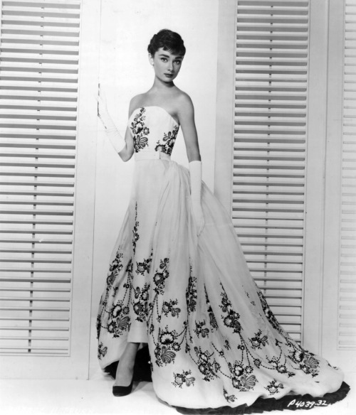 allaboutaudrey:  Audrey in a publicity still for Sabrina, 1954. She picked three pieces from one of Givenchy's collections for the film. This is possibly the most legendary of the three. Number 808 of the Givenchy spring/summer 1953 collection, named 'Inez De Castro'. A white, fitted, strapless ballgown with a detatchable train that falls from waist to floor in a spray of organdy, embroidered with a floral design of black silk thread and jet beads on the bodice, skirt and train. It would mark the beginning of one of fashion's most iconic relationships.