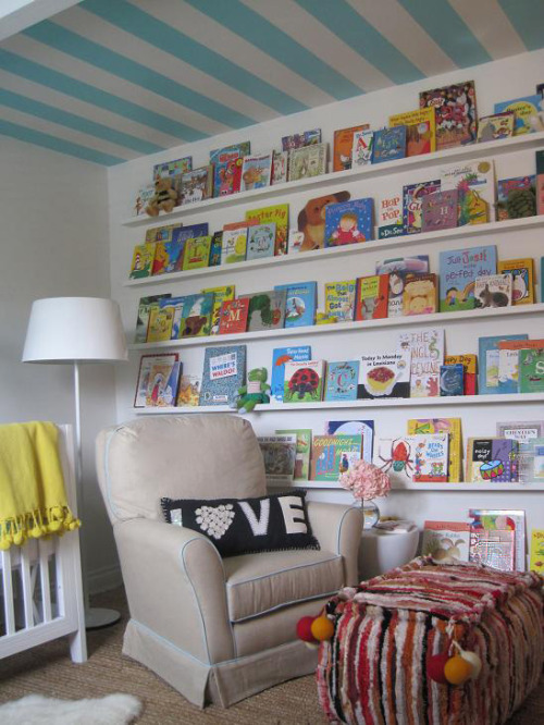 abitofsilliness:  What a cozy little room! Love the wall of books. totallyinspiring:  Elizabeth Sullivan Design via House of Turquoise