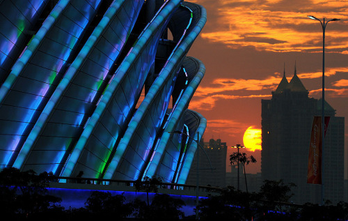 Guangzhou, China — The sun sets behind Haixinsha Stadium shortly before the start of the opening ceremony of the 16th Asian Games in Guangzhou, China. Athletes from 45 countries and territories will compete in 42 sporting disciplines through Nov. 27. PHOTOGRAPH BY: TORSTEN BLACKWOOD / AFP / GETTY IMAGE (via The Week in Pictures | Nov. 8-14, 2010 - Framework - Photos and Video - Visual Storytelling from the Los Angeles Times)