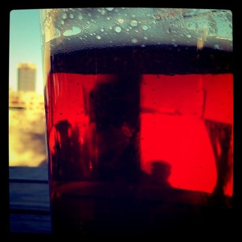 Raleigh, NC skyline through a beer (Taken with instagram at Boylan Bridge Brewpub)