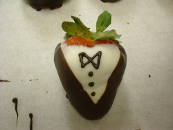A dapper-looking chocolate covered strawberry.