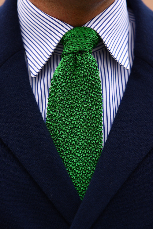 green tie and navy blazer