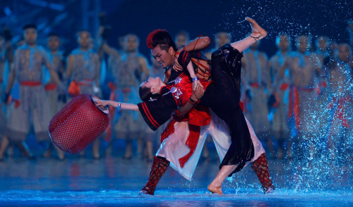 chauda:  Performers dance on a submerged stage during the opening ceremony of the 16th Asian Games on November 12, 2010.