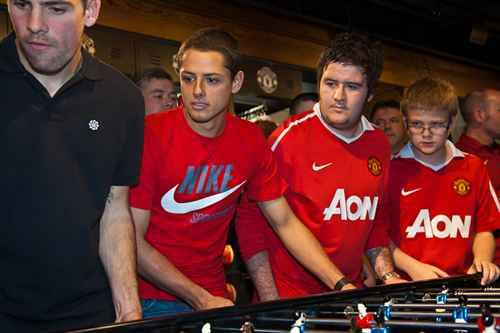 United players playing foosball