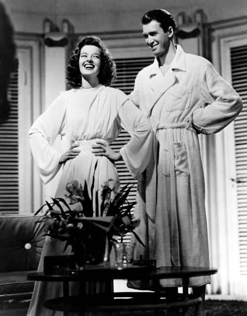 "Katharine Hepburn & Jimmy Stewart in The Philadelphia Story (1940, dir. George Cukor) (via drmacro) ""I loved working with Katharine. She was fun…but she was very  serious about the film. She was almost the producer, and when I had to  do a scene in a bathing suit…well, I just told Katharine that I looked  ridiculous in a bathing suit because my legs were just so thin.  She said, 'Show me your legs,' and she said it with such authority that I  hoisted my pants up until she could see my knees. And she took one look  and said, 'You're right. Those are just the worst legs I've ever seen!' And so she talked [The Philadelphia Story director George] Cukor into letting me do the scene in a bathrobe"". -Stewart on Hepburn, his gams, and filming The Philadelphia Story (quoted in Michael Munn's Jimmy Stewart)"
