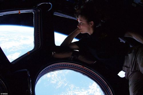 thedailywhat:  Meanwhile, In Space of the Day: Astronaut Tracy Caldwell Dyson takes in the view outside the International Space Station, which orbits the Earth approx. once every 90 minutes. [dailymail.]