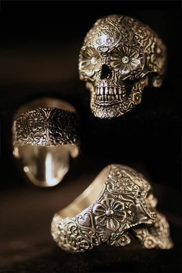 gothiccharmschool:  Oh HELLO, pretty ring. maschalismos:  I. WANT. THIS. RING. ETA: Found the website of the company that makes this ring. The ring is called Sugar Skull and costs $350 in sterling silver. One day, when I become King, I shall be able to have such extravagant eccentricities. For now, I just drool.