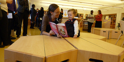 "Prospect Heights Schools' Library Opens With No Librarian (NYT via LISNews)  The shelves were stocked with books. The maple benches were grouped like shin-high honeycombs across the beeswax-colored floor. The Book Hive at P.S. 9 and M.S. 571's joint facility on Underhill Avenue seemed to have everything. Everything, that is, except a librarian. After years of planning, The Book Hive opened on Nov. 12, only to promptly shut its doors. The library, which services two Prospect Heights schools sharing the same building, will remain inactive until the schools hire a librarian, a daunting task in the age of slashed budgets and shared services. ""That's what is so surprising about this whole thing,"" said parent Karen Fein, 42. ""I mean they were willing to get a half a million dollars to construct this library and outfit it beautifully, and now we don't have a librarian.""  This is so sad.  A library needs a librarian.  Even the first graders know this."