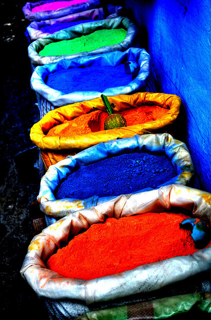 Bags of Colour Outside a shop in Chefchaouen, Morocco, coloured powders for painting. Photo by Tony Shertila