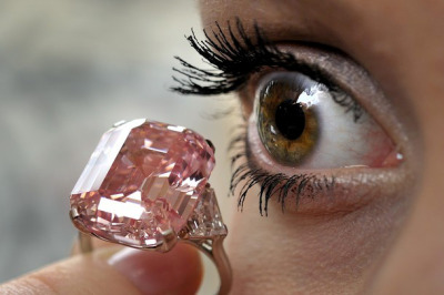Rare Pink Diamond Fetches $45.75m (€33.85m) at Sothebys - I'm not normally one for fancy diamonds and jewels but this is an outrageous record. The rectangular pink diamond, which weighs 24.78 carats, set between shield shaped diamond shoulders, is about the size of a pinball, it is now the world's most expensive jewel sold at auction, bought by the British billionaire jeweller Laurence Graff.