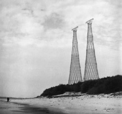 "Shukhov Towers on the Oka  River, 1988 ""Vladimir Shukhov was born in a town of Graivoron, Belgorod Oblast, into a petty noble family. He was a Russian engineer-polymath, scientist and architect renowned for his pioneering works on new methods of analysis for structural engineering that led to breakthroughs in industrial design of world's first hyperboloid structures, lattice shell structures, tensile structures, gridshell structures, oil reservoirs, pipelines, boilers, ships and barges."""