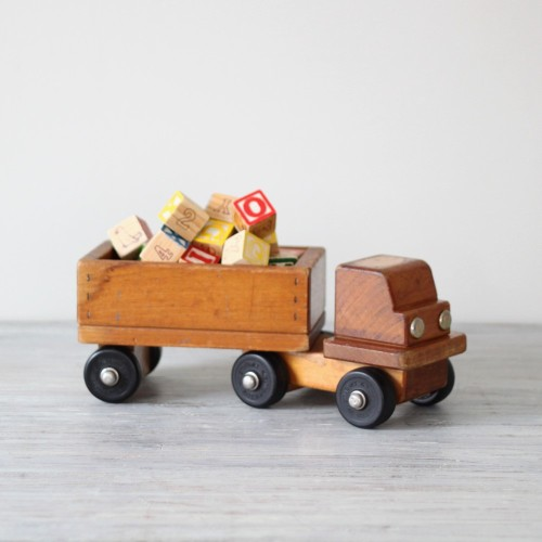 Every time I see a vintage wooden toy, it makes me smile. I just think of all the little sticky hands that must have touched it, all the memories. I always wonder how many times it has been passed down to new generations. Jaxon has received many vintage toys, they are such treasures. My aunt just gave him a giant metal top, I caught him playing with it this morning! I want to start a tradition. This Christmas I am putting a few wooden toys on his wish list, in hopes that he will play with them and one day give them to his children.