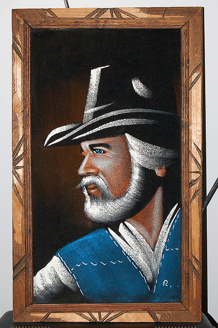 countryandwestern:  I MUST have this black velvet painting of Kenny Rogers to add to my black velvet painting collection (yes, I collect black velvet paintings).