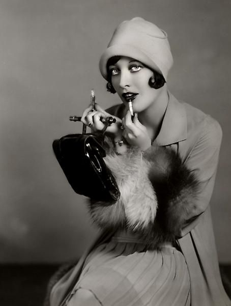 Joan Crawford perfects her lipstick c. Late 1920s