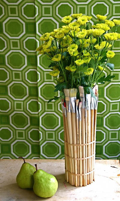 unconsumption:  Don't you love that this use for paintbrushes not only spruces up the outside of a vase (or an empty jar or can), but still enables you to use the paintbrushes? It's a clever way to store art or office supplies such as brushes, pencils, pens, and rubber bands. (via DudeCraft)
