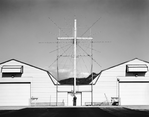"""Potato Processing Plant, WA 2007,"" by Christopher Churchill. From the series, American Faith.  I found this series via Conscientious. It's quite impressive — both for its photography, most of which is excellent, and for its very successful incorporation of audio alongside the images.  Multimedia presentations are of course quite common, and growing more so especially as photographers perceive themselves to be competing for attention with video content. I usually find such inclusion of audio alongside photographs to be at best distracting, and at worst to significantly undermine the impact of the photography.  This is one of the few really notable exceptions. The short segments of spiritual music and interviews are well-edited, and despite being straightforward in content, seem to share a certain allusive quality with Churchill's photographs, which are very straight in style and mostly head-on in composition but which — when taken as a sequence — seem to be gently circumnavigating the question of faith rather than confronting it.  I come away from it feeling that I understand a little more, instead of knowing a little more, which I think is a hallmark of the best contemporary documentary photography. (After all, most Americans today can choose to know as much or as little about each other as they like, with fairly minimal effort.)  I find the subject matter particularly appealing, since religion has always been a source of fascination for me. And I think Churchill's approach to it, which is very diverse without having anything of platitude or generalization about it, is quite fitting to the subject.  But at the same time, because it is oriented toward the cultural experience of religion in America, as opposed to the theological or sociological aspects of faith, I think it should appeal to anyone with a photographic interest in America and Americana."
