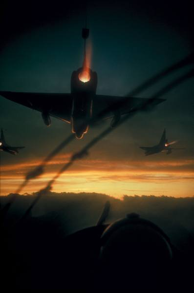 Vietnam1966Larry Burrows / LIFE   American F-102 interceptor fighters flying dawn patrol mission during Vietnam war.   [larger]