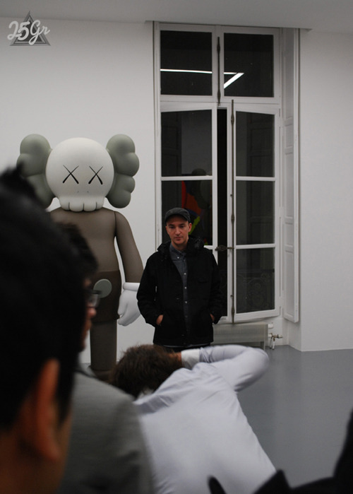 KAWS posing with the Companion statue.