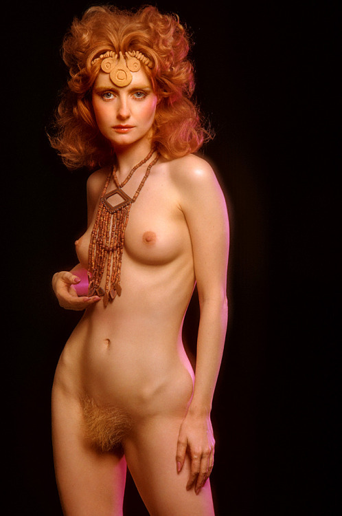 lovesexandhumor:Unknown woman in the 1971 `The Bejeweled Bod` pictorial.Wow, gorgeous! Love her red hair.She sports an impressive fire bush, which shows how much pubic fashion has changed over the years. &#8212 NFJ