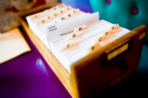 Love the idea of using an old library card catalog as seating cards at a wedding!
