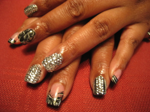 "yesidonails:  This style is called ""studded up"" its one of the newest nail trends that I just added my own nail art too!!!!!! It's a cool winter trend !!!"
