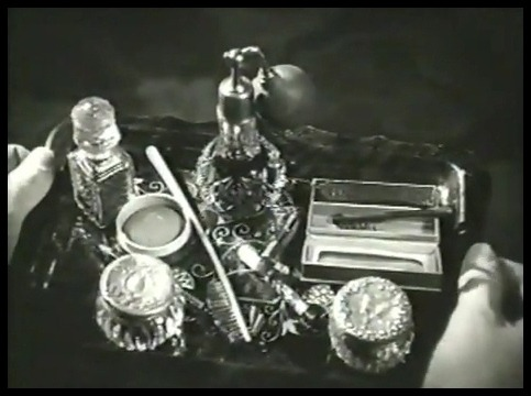 Flapper's makeup and perfume bottles Girl Shy - (1924)