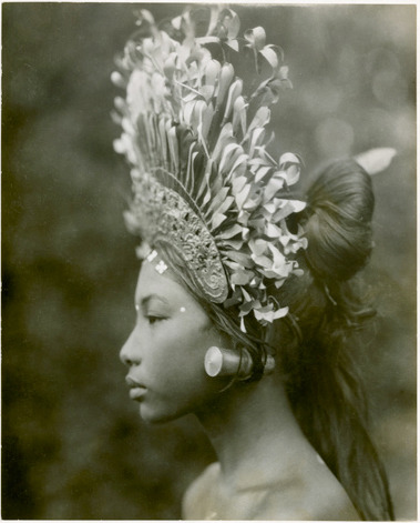 "vestedbee:  Super stunning 1930's headdress. I want it! :) susannacole:  A towering headdress and plug earrings adorn a 1930s Balinese djanger dancer, part of a coed performance that was ""more of popular fun than of temple dance or disciplined art,"" wrote Maynard Owen Williams in his March 1939 Geographic article, ""Bali and Points East."" The dance's male participants ""at times resemble a troupe of cheer leaders made up like Groucho Marx,"" noted Williams. ""Syncopated movement, swaying forms, flashing fingers, and glittering crowns in high relief against deep shadows under the banyan tree—such is the djanger."" — Margaret G. Zackowitz Ph: Andre Roosevelt"