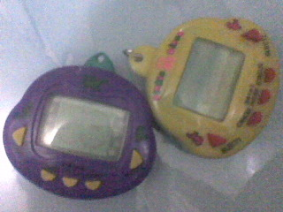 my tamagochi. they're out of battery tho. i've found it. surprise. surprise.