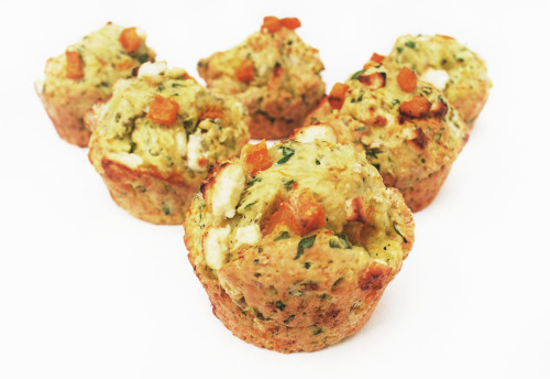 PUMPKIN FETA SAVORY MUFFINS Makes 12 These savory muffins are the perfect companion to your Thanksgiving dinner!  1 tablespoon unsalted butter2 tablespoons olive oil2 cups cubed pumpkin or any winter squash 1 large handful of baby spinach, chopped 2 tablespoons chopped parsley or cilantro 3 tablespoons sunflower seed kernels 3/4 cup freshly grated Parmesan 1/2 cup cubed feta 2 teaspoons whole-grain mustard 2 large eggs, lightly beaten 3/4 cup milk 2 cups flour 4 teaspoons aluminum free baking powder 1 teaspoon fine grain sea salt  Preheat oven to 405°F. Use the butter to grease your muffin pan and set aside. Drizzle the olive oil and sprinkle some salt and pepper over the pumpkin. Toss well and arrange on a single layer on a baking sheet and bake for 15 to 25 minutes, until cooked through entirely. Set aside to cool. In a large mixing bowl, combine two thirds of the pumpkin with the spinach, parsley, sunflower seeds, Parmesan, two thirds of the feta, and all of the mustard.  In a separate mixing bowl, beat the eggs and milk together, adding some salt and a generous amount of freshly ground black pepper. Add to the pumpkin mix. Sift the flour and baking powder and combine. Be careful not to over mix. Spoon the mixture into the prepared pan. Fill each hole 3/4 of the way and top with a bit of the remaining pumpkin and feta.  Bake for 15 to 20 minutes or until golden. Let them cool for a couple minutes and enjoy! Like this recipe?    Recommend DINOSAUR EGG Stumble it